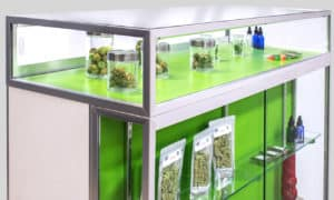 Display multiple products in top glass section and in front glass section with shelves.
